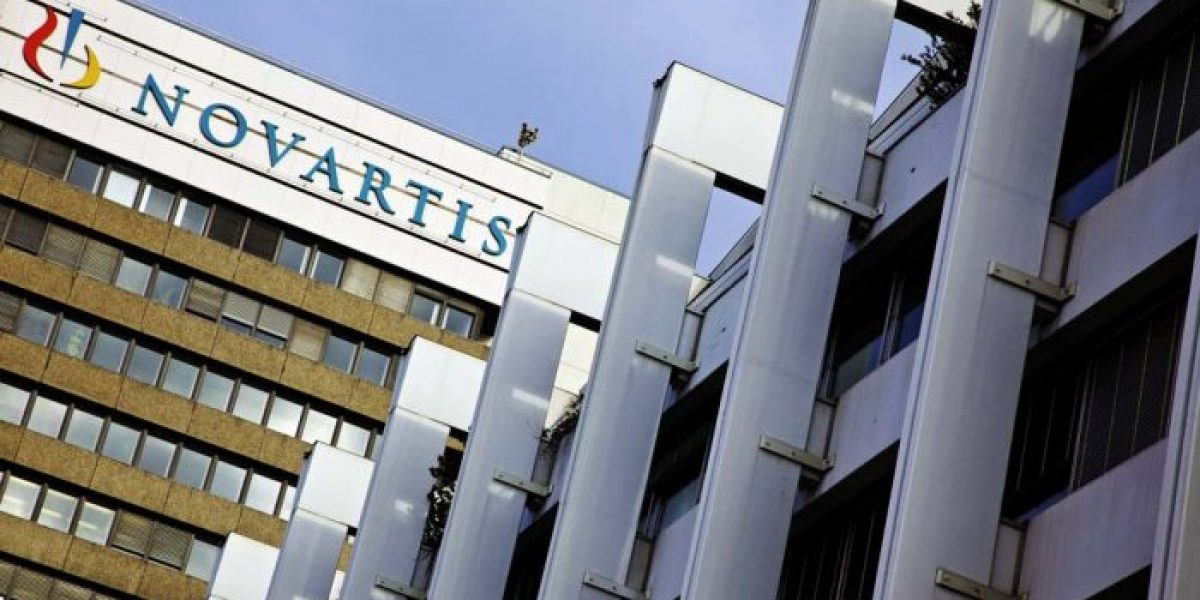 A sign sits on the side of the Novartis AG headquarters in Basel, Switzerland, on Monday, Jan. 23, 2012. Novartis, Europe's second-biggest drugmaker by sales, will boost its payout to shareholders by 9.1 percent to 2.40 Swiss francs, according to Bloomberg via Getty Images Dividend Forecasts that are based on earnings and options prices. Photographer: Gianluca Colla/Bloomberg via Getty Images